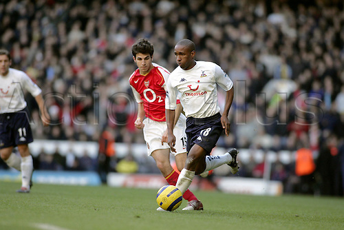 13 November 2004: Spurs striker Jermain Defoe runs with the ball past Arsenal's Cesc Fabregas during the Premiership match between Tottenham Hotspur and Arsenal. Arsenal won the game played at White Hart Lane 5-4. Photo: Action Plus..041113 soccer football premier league premiership players player