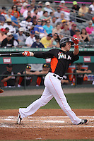 Miami Marlins right fielder Chris Coghlan (8) follows through on his swing against the Houston Astros during a spring training game at the Roger Dean Complex in Jupiter, Florida on March 12, 2013. Houston defeated Miami 9-4. (Stacy Jo Grant/Four Seam Images)........