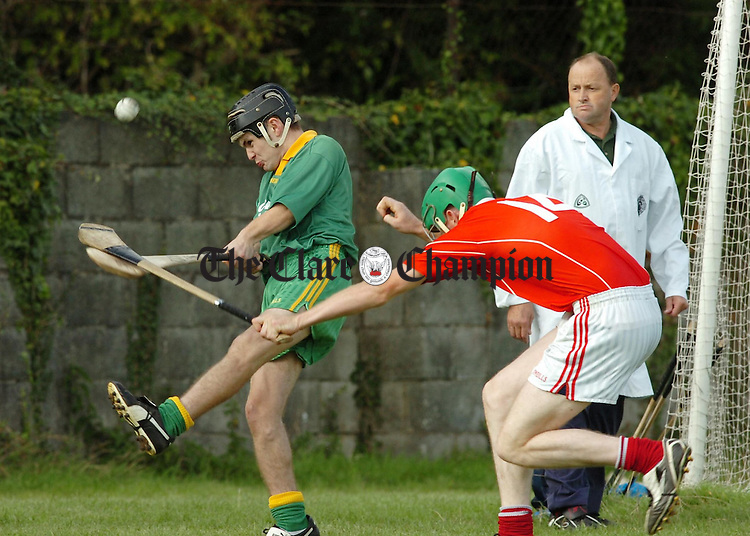 O'Callaghans Mills goalie Sean Torpey clears under pressure from  Crusheens Sean Dillon during their SHC Clash at Clareabbey.Pic Arthur Ellis.