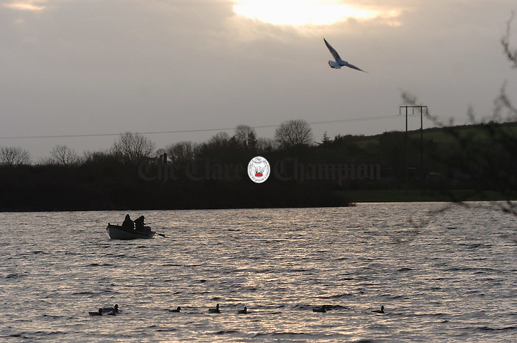 Fishermen make the most of the early days of January at Ballyalla. Photograph by John Kelly.