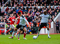 Nottingham Forest's forward Ben Brereton (17) runs past Derby County's defender Curtis Davies (33) and Derby County's defender Andre Wisdom (14) during the Sky Bet Championship match between Nottingham Forest and Derby County at the City Ground, Nottingham, England on 10 March 2018. Photo by Stephen Buckley / PRiME Media Images.