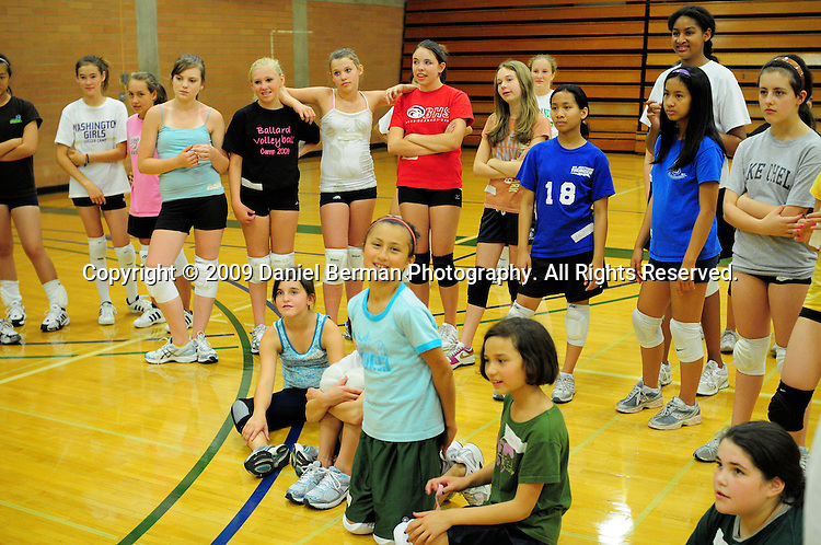 Daniel Berman/Special to The Enterprise..Participants listen to instructions on a warm-up exercise during a youth volleyball camp held Monday July 27 at Shoreline Community College...Shoreline, WA