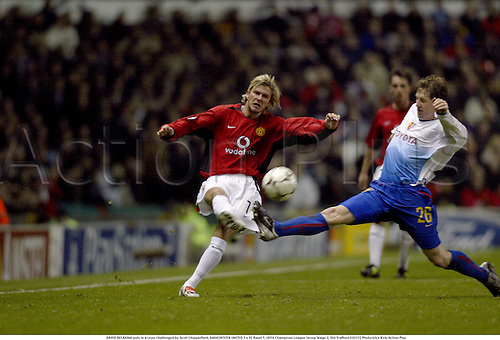 DAVID BECKHAM puts in a cross challenged by Scott Chipperfield, MANCHESTER UNITED 1 v FC Basel 1, UEFA Champions League Group Stage 2, Old Trafford 030312 Photo:Glyn Kirk/Action Plus...2003.Soccer Football utd crosses crossing