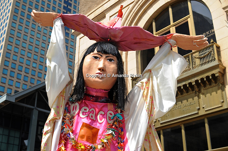 A protester in an elaborate costime marches on the 16th Street Mall ahead of the Democratic National Convention in downtown Denver, Colorado on August 24, 2008.  The Democratic National Convention gets underway Monday August 25, 2008.