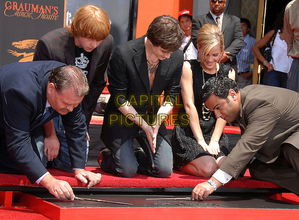 "RUPERT GRINT, DANIEL RADCLIFFE & EMMA WATSON.at The Warner Brothers Presents ""Harry Potter and The Order of The Phoenix"" Hand, Foot & Wand Ceremony held at The Grauman's Chinese Theatre in Hollywood, California, USA, July 09 2007.                                                                                           half length kneeling down prints.CAP/DVS.©Debbie VanStory/Capital Pictures"