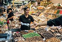 Candy vendor in la Boqueria market, Barcelona, Spain.