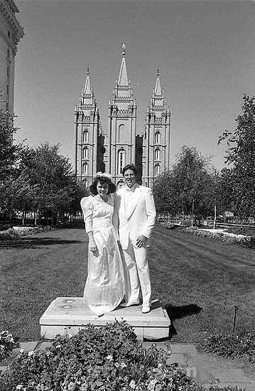 Dave and Faye Watkins in front of the temple on their wedding day.<br />