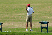 Kailua, Hawaii - December 29, 2008 -- United States President-elect Barack Obama stretches before warming up on the driving range to play golf with friends in Kailua, Hawaii on Monday, December 29, 2008. Obama and his family arrived in his native Hawaii December 20 for the Christmas holiday..Credit: Joaquin Siopack - Pool via CNP