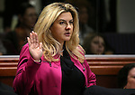 Nevada Assemblywoman Michele Fiore, R-Las Vegas, takes the oath of office during opening day ceremonies at the Legislative Building in Carson City, Nev., on Monday, Feb. 2, 2015. (Cathleen Allison/Las Vegas Review-Journal)