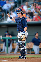 Mobile BayBears catcher Michael Barash (16) signals to the defense during a game against the Jacksonville Jumbo Shrimp on April 14, 2018 at Baseball Grounds of Jacksonville in Jacksonville, Florida.  Mobile defeated Jacksonville 13-3.  (Mike Janes/Four Seam Images)
