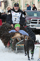 Scott Janssen and team leave the ceremonial start line with an Iditarider at 4th Avenue and D Street in downtown Anchorage, Alaska on Saturday, March 5th during the 2016 Iditarod race. Photo by Joshua Borough/SchultzPhoto.com