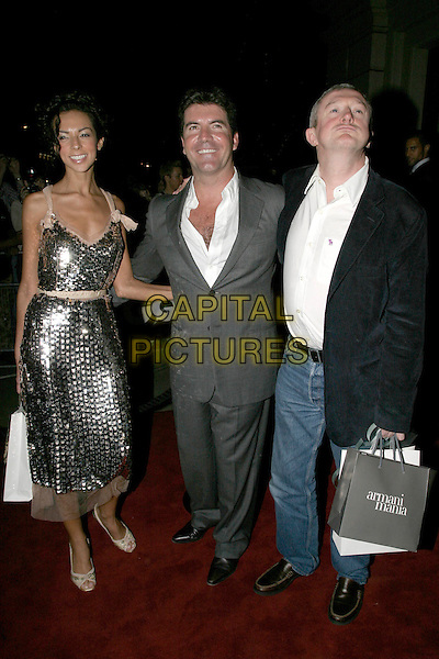 TERRI SEYMORE, SIMON COWELL & LOUIS WALSH.The 8th Anual GQ Men of The Year Awards,.The Royal Opera House,.London, 6th September 2005.full length navy jacket grey gray suit bags.www.capitalpictures.com.sales@capitalpictures.com.© Capital Pictures.