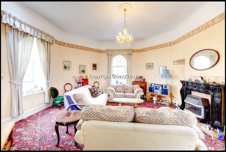 BNPS.co.uk (01202 558833)<br /> Pic: next2buy/BNPS<br /> <br /> ***Please use full byline*** <br /> <br /> The lounge.<br /> <br /> An Englishman's home is his castle...<br /> <br /> An incredible property that looks like a miniature castle has come on the market for the bargain price of &pound;250,000.<br /> <br /> The Grade II listed building was erected in 1720 and features an amazing turret that boasts countryside and harbour views.<br /> <br /> It was originally used as a watch tower and the rest of the building was used as an office by the harbour master.<br /> <br /> The building, which is in Whitley Bay, Tyne and Wear, boasts four bedrooms, an open plan kitchen and dining room, and a spacious living room.<br /> <br /> It also has a yard at the back and is just a stone's throw away from the stunning coastal walk surrounding Colywell Bay.<br /> <br /> The property is being sold through Next2Buy estate agents who are based in Tyneside.