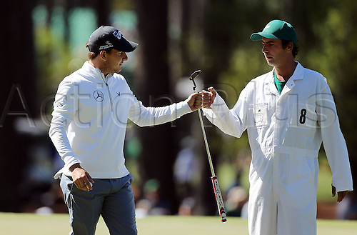 07.04.2016. Augusta, GA, USA. Emiliano Grillo fist bumps caddie Jose Luis Campo following a birdie on the third green during the first round of the Masters Golf Tournament on Thursday, April 7, 2016, at Augusta National Golf Club in Augusta, Ga