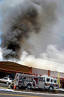 AJ ALEXANDER/AAP- 071709 - Richardson's Restaurant is a well know Valley restaurant in central Phoenix, goes up in flames and smoke that started some time after 2 p.m.  on this 113 degree day. The stip mall is located on Bethany Home Rd. & 16th St. Friday July 17, 2009.  Photo by AJ Alexander