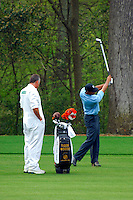 Masters Golf Tournament 2005, Augusta National Georgia, USA. Tiger Woods hitting a 9 iron onto the 11th hole, White Dogwood<br /> <br /> Champion 2005 - Tiger Woods <br /> <br /> Note: There is no property release or model release available for this image.