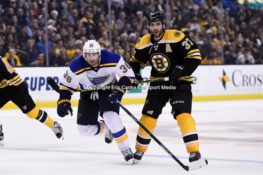 Tuesday, December 22, 2015: Boston Bruins center Patrice Bergeron (37) gets his stick under St. Louis Blues right wing Troy Brouwer (36) during the National Hockey League game between the St. Louis Blues and the Boston Bruins held at TD Garden, in Boston, Massachusetts. The blues beat the Bruins 2-0 in regulation time. Eric Canha/CSM