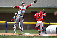 Lowell Spinners first baseman Sam Travis (40) jumps for a wild throw as Mason Davis (7) runs up the line during a game against the Batavia Muckdogs on July 17, 2014 at Dwyer Stadium in Batavia, New York.  Batavia defeated Lowell 4-3.  (Mike Janes/Four Seam Images)
