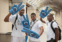 From left, Bobby Phillips '12, Justin Morgan '09 and Darrell Winfrey '12 pose outside the Samuelson Pavilion (Tiger Cooler) on Oct. 31, 2008. The three were selling foam Barack Obama hands for the 2008 presidential election.<br /> (Photo by Marc Campos, Occidental College Photographer)