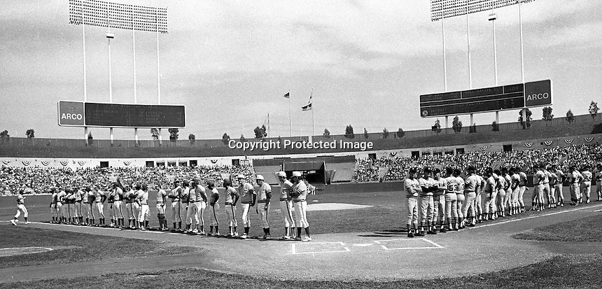 Opening game of the 1972 American League playoffs at the Oakland-Alameda County Coliseum. The Oakland Athletics and the Detroit Tigers line the foul lines.<br />
