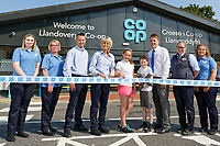 Lewis Eadys and Jasmine Hughes (both C) from year 6 of ysgol Rhys Pritchard cut the ribbon with store staff (L-R) Honor Sanders, Shell Fuga, Paul Richardson, Sue Yelland, manager Gethin Adams, Angharad Morgan and Yasmin Yelland