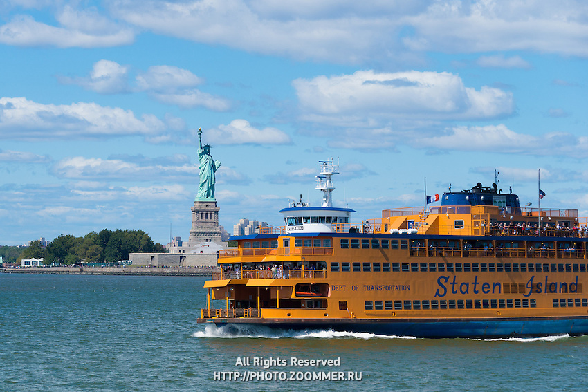 Staten island ferry passing by Liberty island and Statue of Liberty, New York