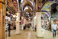 Low angle view through Grand Bazaar, 15th century, Istanbul, Turkey. The Grand Bazaar, containing two bedestens (storage domes) is one of the largest and oldest covered markets in the world, selling jewellery, pottery, spice, and carpets. It was restored in the 16th and 19th centuries. Picture by Manuel Cohen.