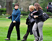 Washington, D.C. - March 25, 2010 -- Left to right: Valerie Jarrett, senior advisor and assistant to the president for Public Engagement and Intergovernmental Affairs; Linda Douglass, Director of Communications for the White House Office of Health Reform; and Katie Johnson, personal secretary to United States President Barack Obama, walk across the South Lawn of the White House to accompany the President aboard Marine 1 for Iowa City, Iowa where he will deliver remarks on the benefits of his health care reform bill which was signed earlier in the week on Thursday, March 25, 2010..Credit: Ron Sachs / Pool via CNP