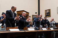 The room applauds Luis Alvarez, after delivering his testimony at a hearing on the 9-11 Victims fund before the Judiciary subcommittee on Capitol Hill in Washington D.C. on June 11, 2019.<br /> <br /> Credit: Stefani Reynolds / CNP/AdMedia