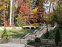 A beautiful view of the steps, turning back from the fountain to the Duke Gardens Entrance. The picture captures the beatiful fall colors on the trees, as well as the beautiful stone wall and steps leading to the very entrance to the Duke Gardens.