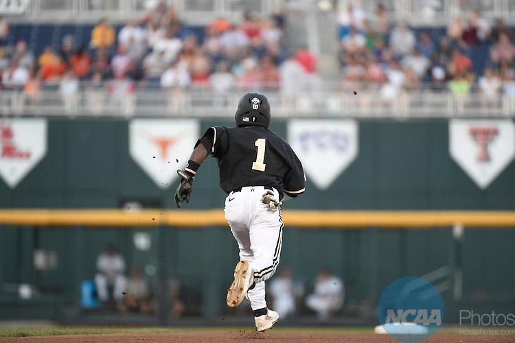 25 JUNE 2014:  The University of Virginia takes on Vanderbilt University during the Division I Men's Baseball Championship held at TD Ameritrade Park in Omaha, NE.  Vanderbilt defeated Virginia 3-2 for the national title.  Jamie Schwaberow/NCAA Photos