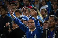 BOGOTA - COLOMBIA, 11-01-2019: Hincha de Millonarios, reacciona tras una falta causada a un jugador, durante partido entre Millonarios y Atlético Nacional, por el Torneo Fox Sports 2019, jugado en el estadio Nemesio Camacho El Campin de la ciudad de Bogotá. / <br /> Fan of Millonarios, reacts after a fault caused to a player, during a match between Millonarios y Atletico Nacional, for the Fox Sports Tournament 2019, played at the Nemesio Camacho El Campin stadium in the city of Bogota. Photo: VizzorImage / Diego Cuevas / Cont.