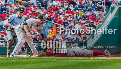 30 August 2015: Miami Marlins third baseman Martin Prado tags Washington Nationals outfielder Matt den Dekker out at third on a runner's fielder choice play in the 8th inning at Nationals Park in Washington, DC. The Nationals rallied to defeat the Marlins 7-4 in the third game of their 3-game weekend series. Mandatory Credit: Ed Wolfstein Photo *** RAW (NEF) Image File Available ***