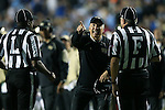 17 October 2015: Wake Forest head coach Dave Clawson (center) tries to get Field Judge Harry Tyson (F) and Line Judge Deon Lawrence (L) watch a replay on the scoreboard. The University of North Carolina Tar Heels hosted the Wake Foresst University Demon Deacons at Kenan Memorial Stadium in Chapel Hill, North Carolina in a 2015 NCAA Division I College Football game. UNC won the game 50-14.