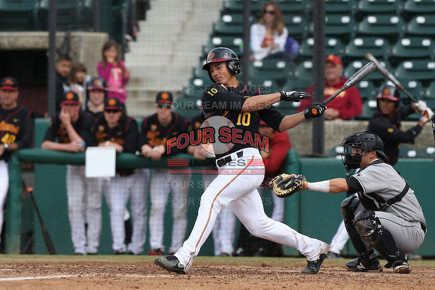 A.J. Ramirez #10 of the USC Trojans bats against the Cal Poly Mustangs at Dedeaux Field on March 2, 2014 in Los Angeles, California. Cal Poly defeated USC, 5-1. (Larry Goren/Four Seam Images)