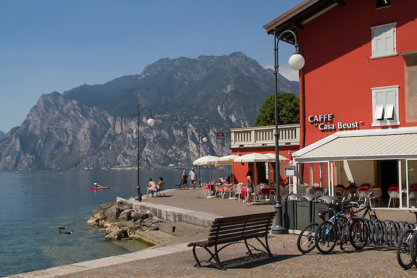 Cafe and visitors along Lake Garda, northern Italy,