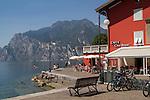 Cafe and visitors along Lake Garda, northern Italy,