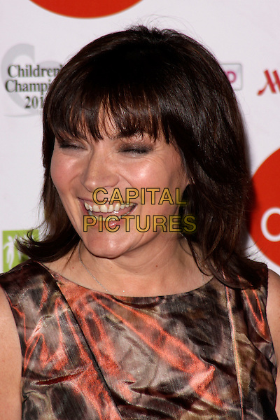 LORRAINE KELLY.The News Of The World Children's Champion Awards 2011 at the Grosvenor House Hotel, London, England, UK, 30th March 2011.headshot portrait smiling fringe brown red print sleeveless  .CAP/AH.©Adam Houghton/Capital Pictures.