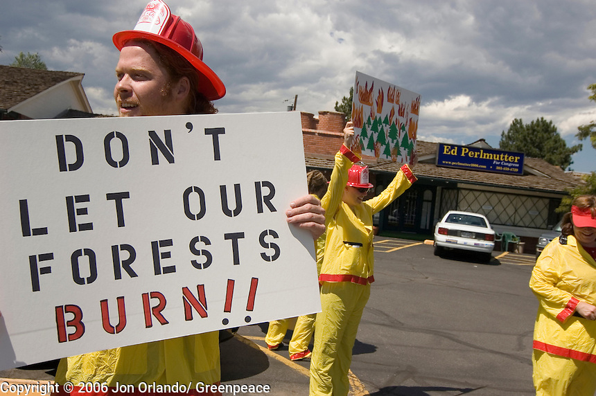 Greenpeace activist, Carson Israel,  at a rally to raise awareness of the threats of global warming, outside the headquarters of Ed Perlmutter, a Democratic congressional  candidate for district 7 in Colorado.