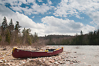A canoe beached during a break from paddling on the Agawa River of Ontario Canada.