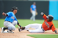 Akron RubberDucks shortstop Ivan Castillo (1) tags out Julio Borbon (24) sliding into second base during the first game of a doubleheader against the Bowie Baysox on June 5, 2016 at Prince George's Stadium in Bowie, Maryland.  Bowie defeated Akron 6-0.  (Mike Janes/Four Seam Images)