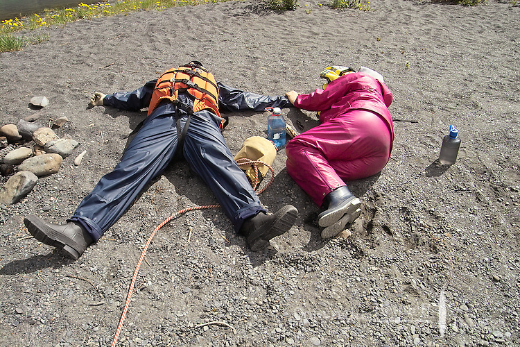 Nick Lynch and Kirsten Olsen take a break from rafting by soaking up the early spring sun along the Kenai River.