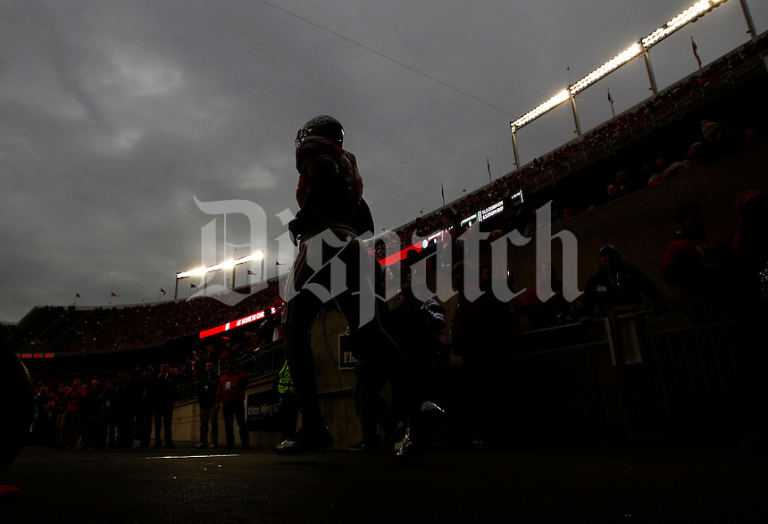 Ohio State Buckeyes linebacker Joshua Perry (37) heads on to the field for warms up before the college football game between the Ohio State Buckeyes and the Michigan State Spartans at Ohio Stadium in Columbus, Saturday afternoon, November 21, 2015.  (The Columbus Dispatch / Eamon Queeney)