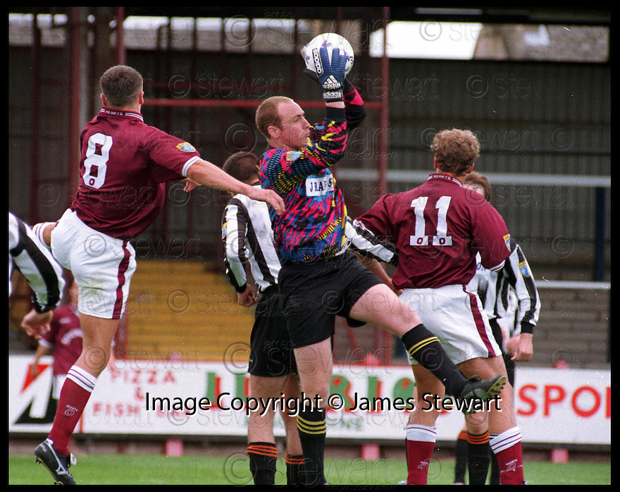 18th July 98      Copyright Pic : James Stewart   .EAST STIRLINGSHIRE V HEARTS XI.SHIRE KEEPER GORDON MCDOUGALL GETS TO THE BALL AHEAD OF HEARTS NO.8 SCOTT SEVERIN AND NO.11 CHRISTIAN SCHANDL......Payments to :-.James Stewart Photo Agency, Stewart House, Stewart Road, Falkirk. FK2 7AS      Vat Reg No. 607 6932 25.Office : 01324 630007        Mobile : 0421 416997.If you require further information then contact Jim Stewart on any of the numbers above.........