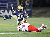 Annapolis, MD - November 11, 2017: Navy Midshipmen running back John Brown III (20) is tackled by Southern Methodist Mustangs defensive back Cedric Lancaster (3)during the game between SMU and Navy at  Navy-Marine Corps Memorial Stadium in Annapolis, MD.   (Photo by Elliott Brown/Media Images International)