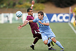 13 November 2011: North Carolina's Ben Speas (17) gets past Boston College's Stefan Carter (behind). The University of North Carolina Tar Heels defeated the Boston College Eagles 3-1 at WakeMed Stadium in Cary, North Carolina in the Atlantic Coast Conference Men's Soccer Tournament championship game.