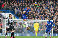 Cesar Azpilicueta of Chelsea (centre) heads the ball clear during the Premier League match between Chelsea and Newcastle United at Stamford Bridge, London, England on 2 December 2017. Photo by David Horn.