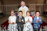 Fr Brendan Walsh PP Causeway Parish with the pupils of Scoil Choiste Ri,Drummacurra,NS Sarah Diggins,Shane Leahy,Megan Barrett and Ruairí Walsh, on Saturday after they made their First Holy Communion in St John's Church,Causeway.