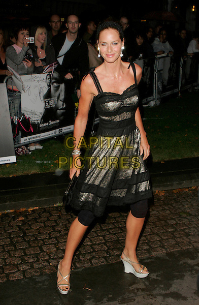 """TRINNY WOODALL.UK premiere of """"The Bourne Ultimatum"""", Odeon Leicester Square, London, England..August 15th, 2007.full length black grey gray silver lace dress wedges platform shoes leggings .CAP/AH.©Adam Houghton/Capital Pictures"""
