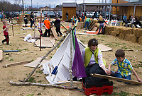 NWA Democrat-Gazette/CHARLIE KAIJO Viah Carlson of Bentonville (from center to left) plays with found materials with Gavin Radmer, 6, Monday, March 19, 2018 at the Amazeum in Bentonville. <br /><br />The adventure playground or &quot;junk playground&quot; allows kids to create their own play space from found materials. The idea is based on a theory of play in existence in Europe since after World War II. People noticed children were playing more in spaces that were bombed out and had loose parts they could interact with rather than the adult designed playgrounds said Jess Graff of Portland, Ore. who brought the idea to Amazeum.<br /><br />&quot;Kids can build a lot of different skills, independence, confidence, teamwork,&quot; Graff said. &quot;As adults we can remember a time as a child we were having a fantastic time. Often those are experiences where there&Otilde;s a little bit of risk involved in the play.&quot;